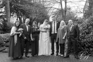 Bridal party group wedding photo in the gardens at the York registry office