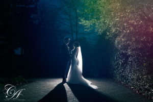 Bride and Groom facing each other in the rain at the York registry office
