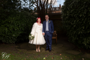 Bride and groom stood side by side in the York Registry Office gardens, york wedding photography