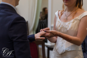 The bride placing the ring on the grooms finger at York Register Office