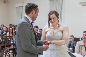 Groom placing the ring on the brides finger at the York Regisrty Office, York
