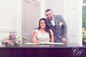 Bride and Groom signing the register, at York Registry Office