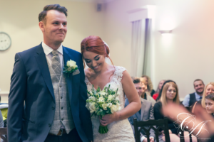 Bride resting her head on the grooms shoulder during their ceremony at The York Register Office