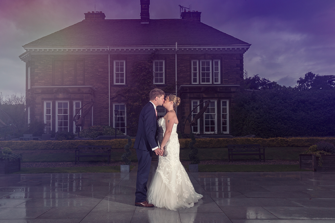 Bride and Groom kissing in front of the Judges Country House Hotel in Yarm.