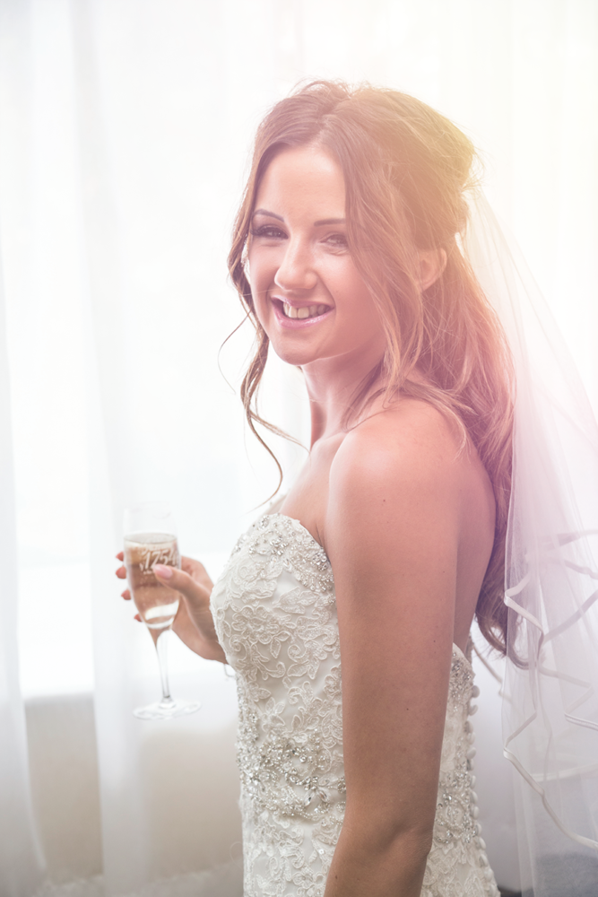 Bride on her own in the bridal suite in York Marriott Hotel.