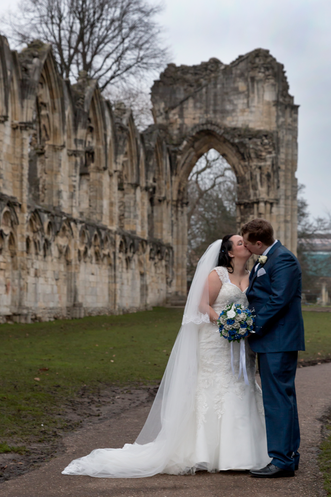 Bride and groom kissing at York Hospitium