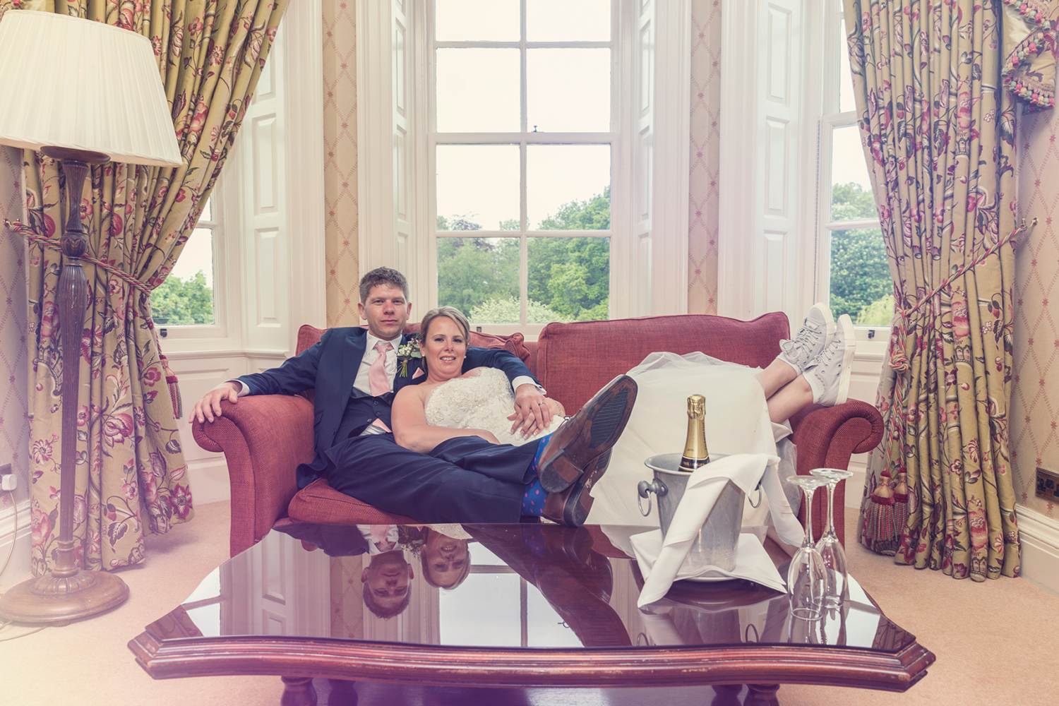 Bride and Groom relaxing on the sofa at Judges Country House Hotel Yarm