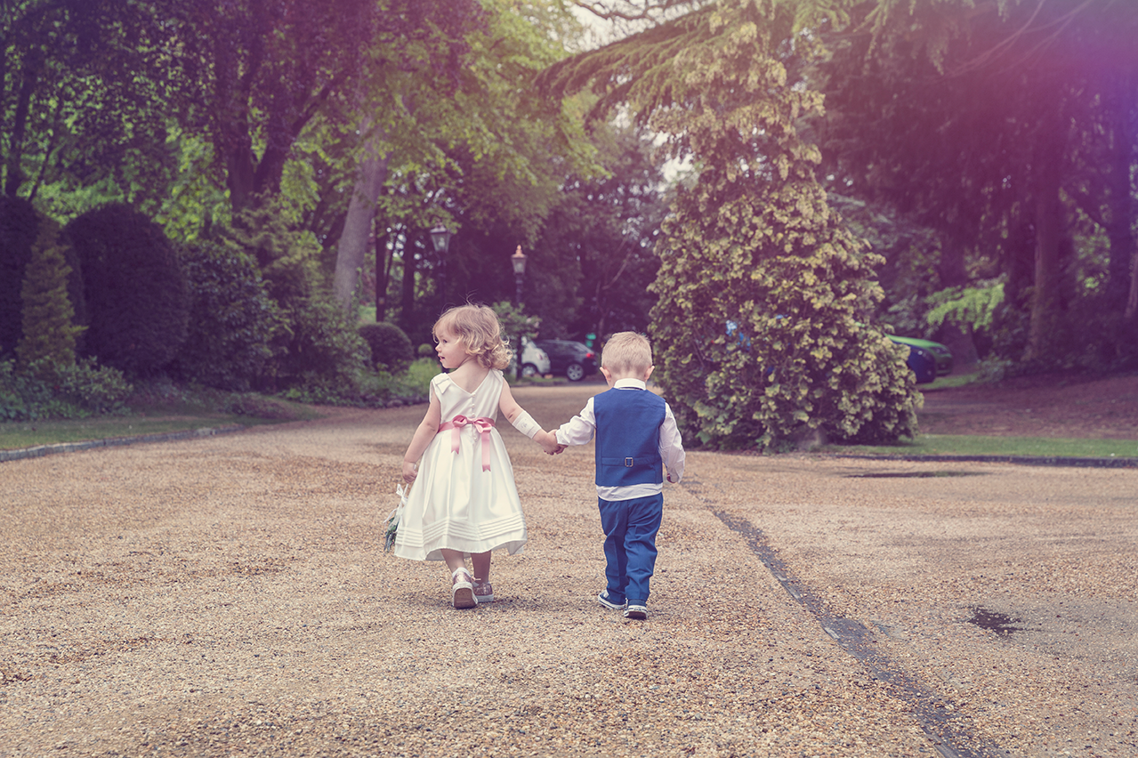 Kids at a wedding holding hands