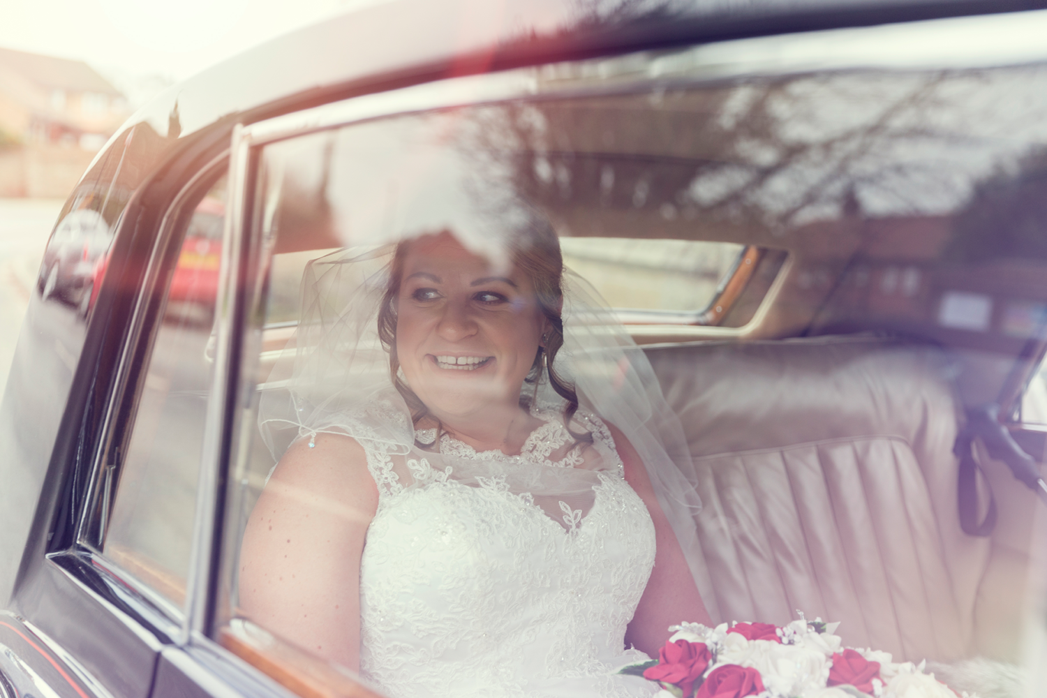 Bride in the car on the way to Rufforth Church, York.