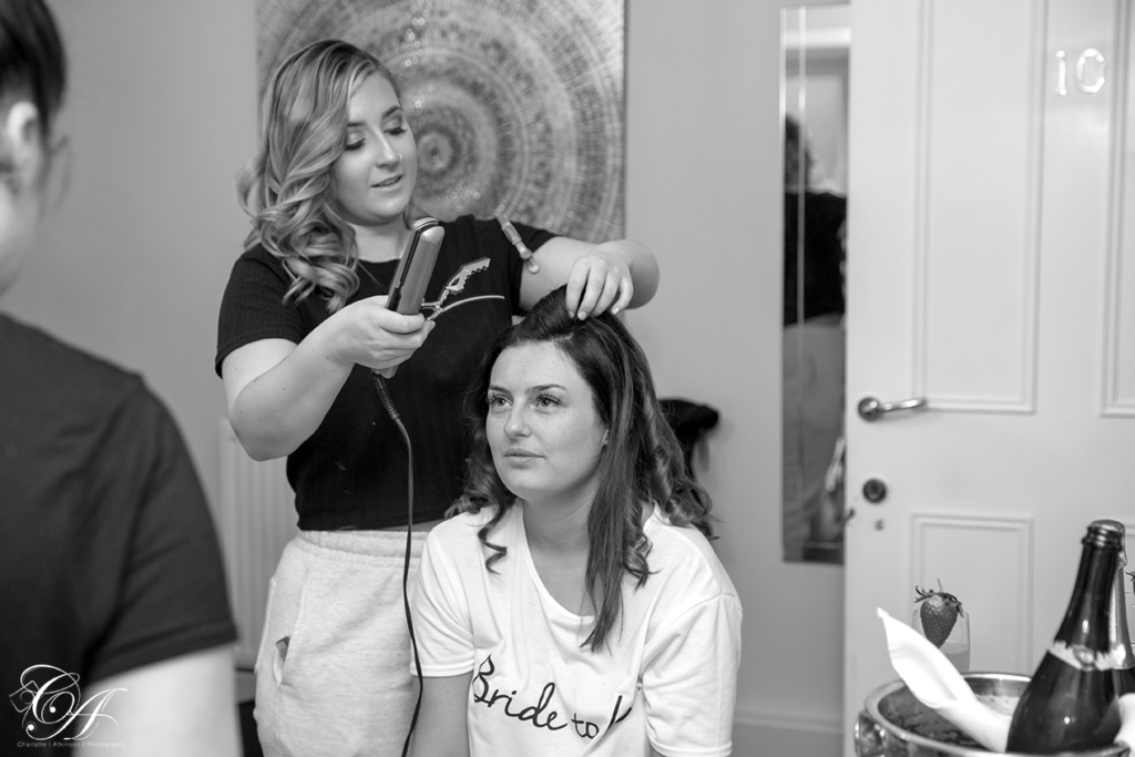 Bride getting her hair styled for her York Wedding