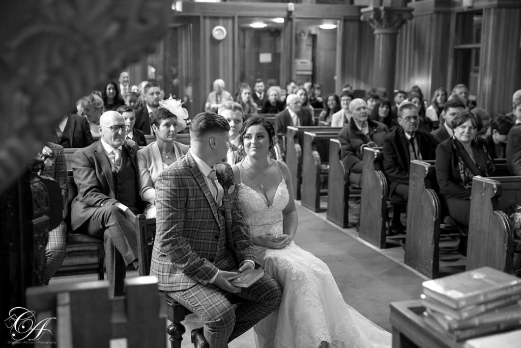 Bride and groom sat at the front of the church during their York Wedding service