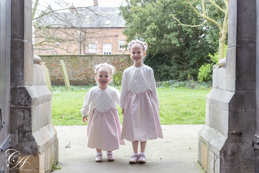 The two flower girls stood in the door way of the church. York Wedding Photography