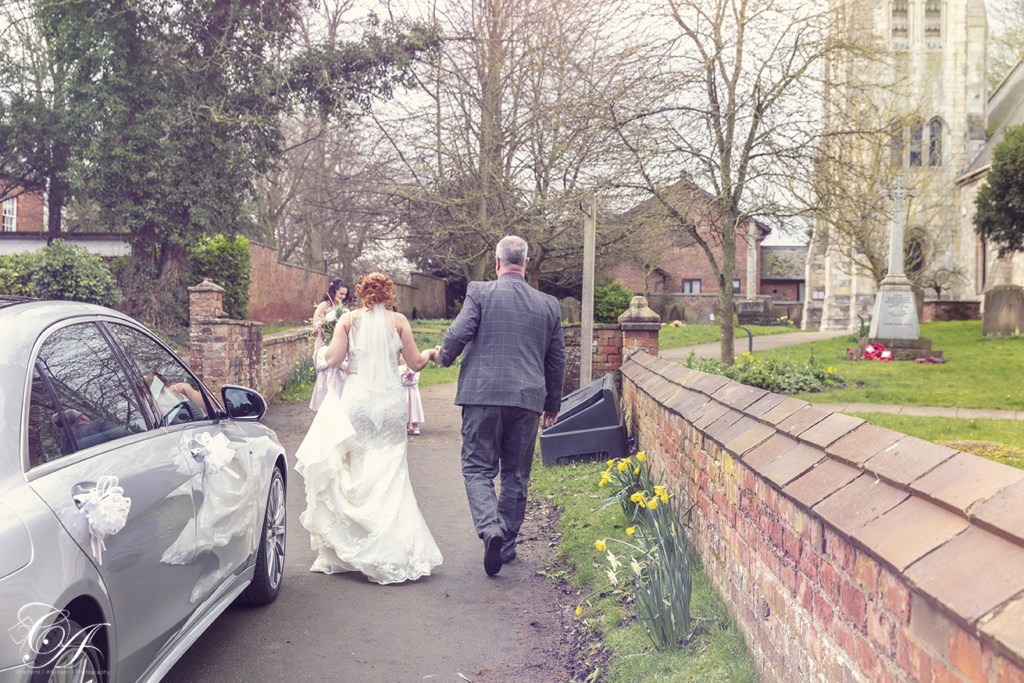 Father and daughter walking towards the church. York Wedding