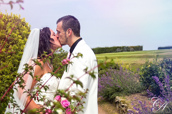 Couple kissing in the garden at Raven Hall Hotel. Ravenscar Wedding Photography