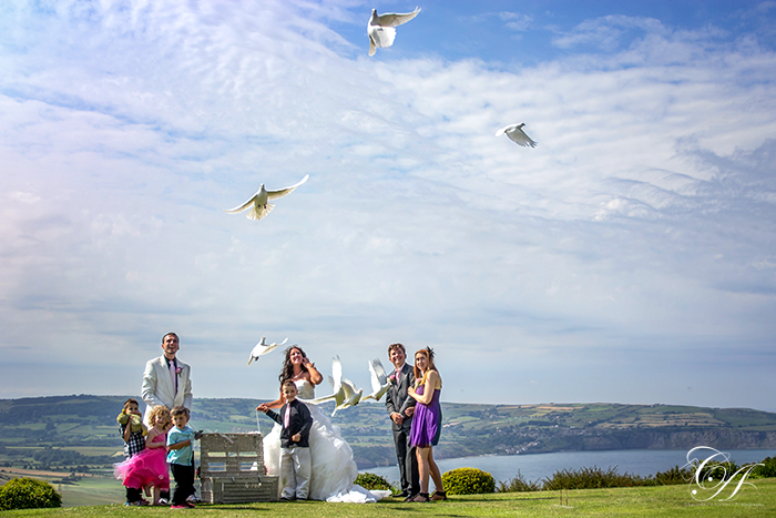 Dove release. Raven Hall Hotel Wedding Photography