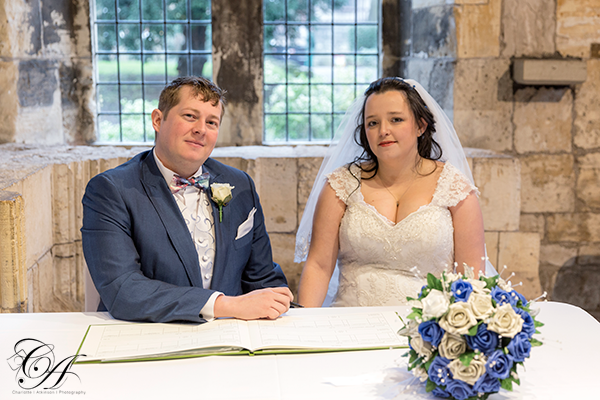 Signing the register at The Hospitium, York Wedding Photographer